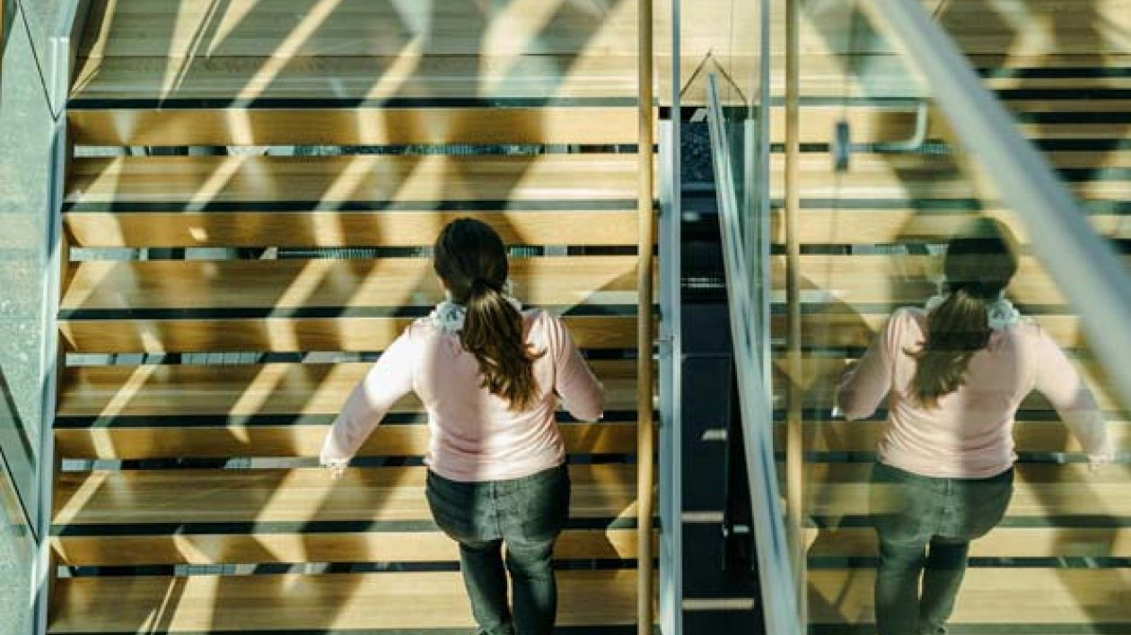 Student walking up stairs on Lahti Campus